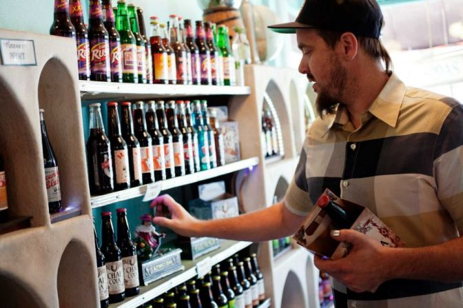 Co-owner Taylor Peck stocks sodas at the Fizzary shop in the Mission District.